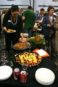 Guests enjoy fruit kebabs and prawn canapes