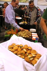 Guest enjoy mini burgers and mini quiches